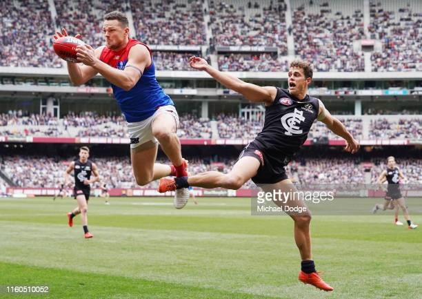 Steven May of the Demons marks the ball against Ed Curnow of the Blues during the round 16 AFL match between the Carlton Blues and the Melbourne...