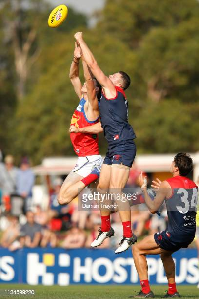 Steven May of the Demons spoils Eric Hipwood of the Lions during the 2019 JLT Community Series AFL match between the Melbourne Demons and the...
