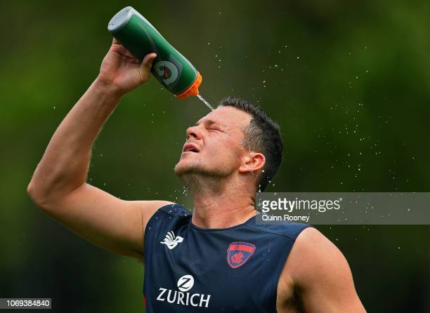 Steven May of the Demons sprays himself with water during a Melbourne Demons AFL training session at Gosch's Paddock on November 19 2018 in Melbourne...