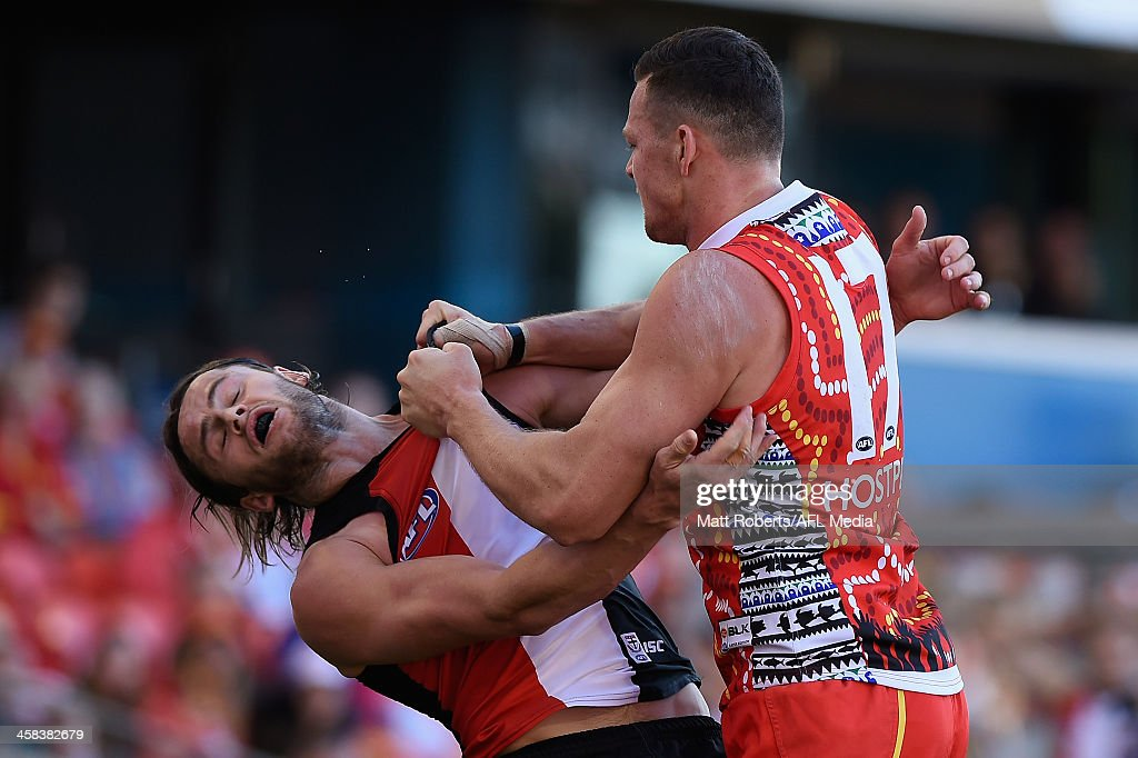 Steven May of the Suns and Maverick Weller of the Saints wrestle during the round 15 AFL match between the Gold Coast Suns and the St Kilda Saints at Metricon Stadium on July 2, 2016 in Gold Coast, Australia.