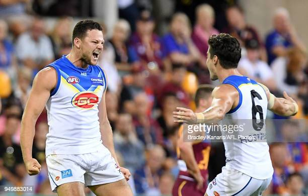 Steven May of the Suns celebrates after kicking a goal during the round five AFL match between the Brisbane Lions and the Gold Coast Suns at The...