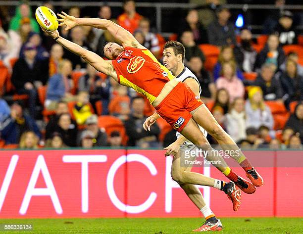 Steven May of the Suns dives for the ball during the round 20 AFL match between the Gold Coast Suns and the Grater Western Sydney Giants at Metricon...