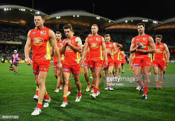 Steven May of the Suns leads his team from the field after being defeated by the Power during the round 23 AFL match between the Port Adelaide Power...