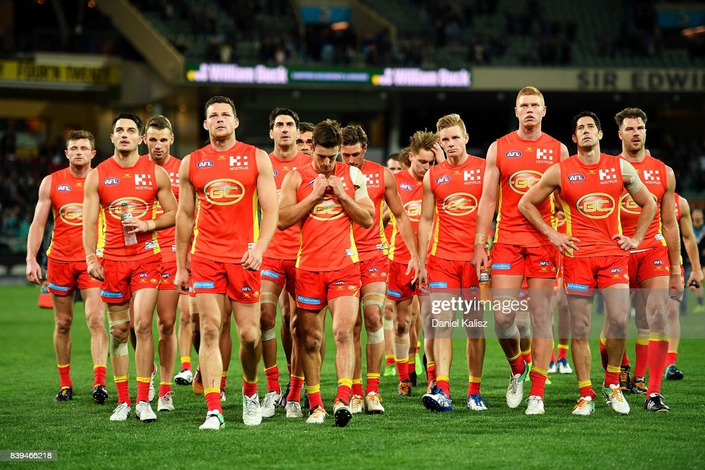 Steven May of the Suns leads his team from the field looking dejected after being defeated by the Power during the round 23 AFL match between the Port Adelaide Power and the Gold Coast Suns at Adelaide Oval on August 26, 2017 in Adelaide, Australia.