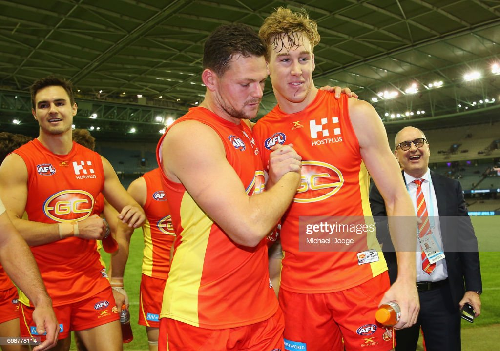 Steven May (L) of the Suns leads the team off with Tom Lynch of the Suns after their win during the round four AFL match between the Carlton Blues and the Gold Coast Suns at Etihad Stadium on April 15, 2017 in Melbourne, Australia.