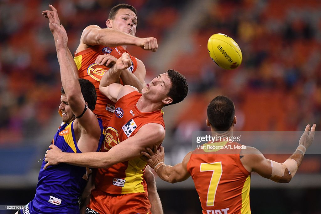 Steven May of the Suns spoils the mark during the round 18 AFL match between the Gold Coast Suns and the West Coast Eagles at Metricon Stadium on August 1, 2015 in Gold Coast, Australia.