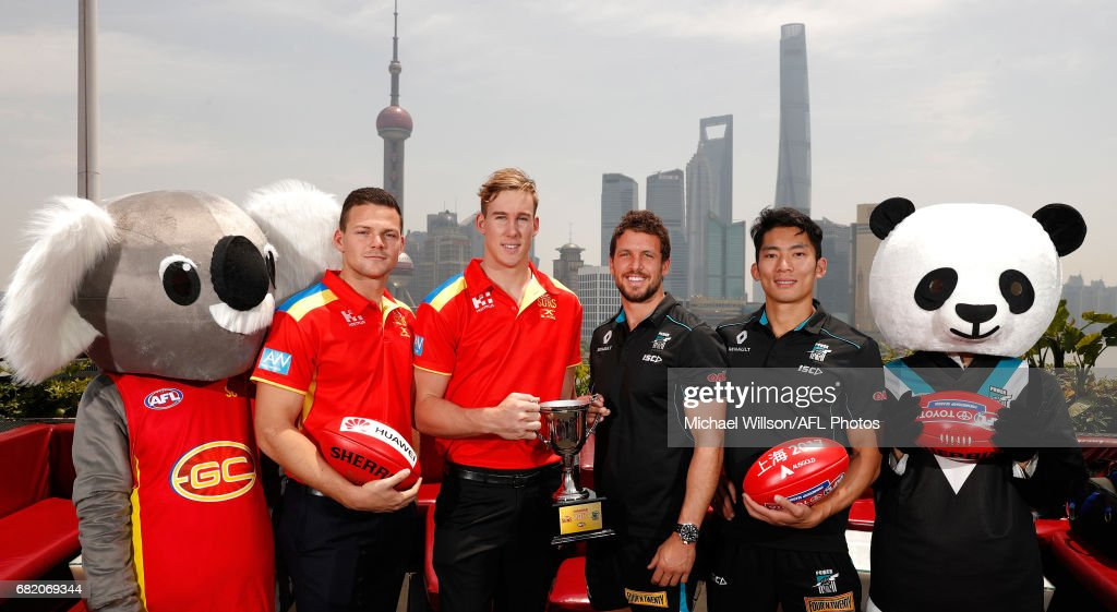 Steven May of the Suns, Tom Lynch of the Suns, Travis Boak of the Power and Chen Shaoliang of the Power pose for a photograph with the 2017 Shanghai Cup during the Port Adelaide Power and Gold Coast Suns joint Captain and Coach press conference at Bar Rouge overlooking The Bund on May 11, 2017 in Shanghai, China.