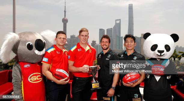 Steven May of the Suns Tom Lynch of the Suns Travis Boak of the Power and Chen Shaoliang of the Power pose for a photograph with the 2017 Shanghai...