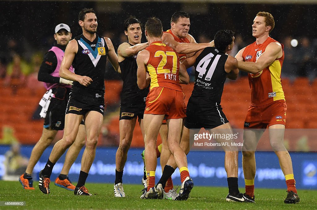 Steven May of the Suns wrestles with Brendon Ah Chee of the Power during the round 22 AFL match between the Gold Coast Suns and the Port Adelaide Power at Metricon Stadium on August 29, 2015 on the Gold Coast, Australia.