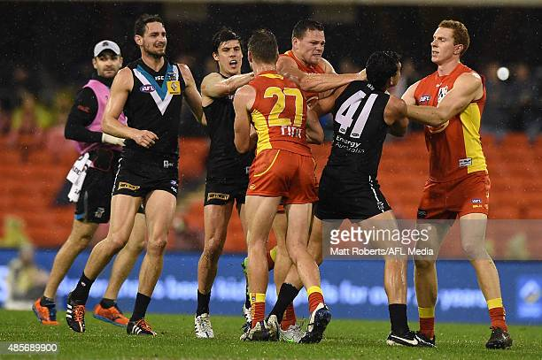 Steven May of the Suns wrestles with Brendon Ah Chee of the Power during the round 22 AFL match between the Gold Coast Suns and the Port Adelaide...