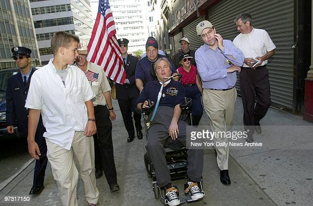 Steven McDonald a New York City cop left quadriplegic by a gunshot wound that severed his spinal cord leads a march in his wheelchair from St Francis...