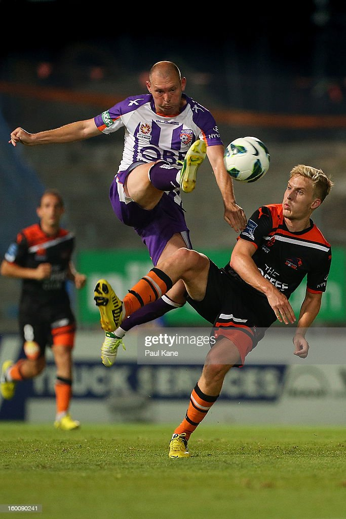 Steven McGarry (L) of the Glory and Ben Halloran of the Roar contest for the ball during the round 18 A-League match between the Perth Glory and the Brisbane Roar at nib Stadium on January 26, 2013 in Perth, Australia.