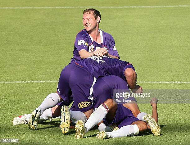 Steven McGarry of the Glory looks on after players celebrate a goal scored by Andrija Jukic during the round 25 ALeague match between the Perth Glory...