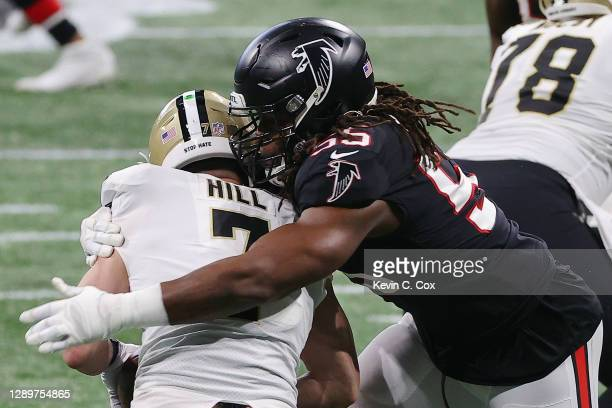 Steven Means of the Atlanta Falcons sacks Taysom Hill of the New Orleans Saints during the first quarter at Mercedes-Benz Stadium on December 06,...