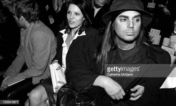 Steven Meisel with unidentified woman at Versace Versus fashion show on March 27 1996 in New York City New York