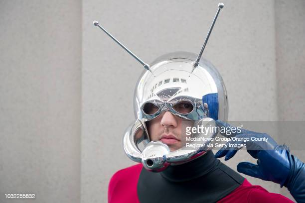 Steven Meissner of Los Angeles as Antman poses for a photo in his handmade helmet during day two of ComicCon International at the San Diego...