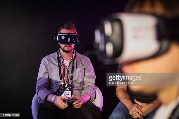 Steven Messner experiences the Minecraft for Gear VR during a press demonstration at The Village event space in San Francisco California on March 15...