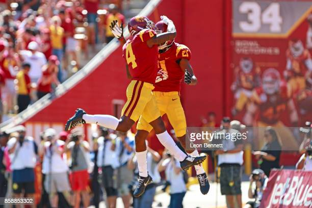 Steven Mitchell Jr #4 and Tyler Vaughns of the USC Trojans celebrate a first quarter touch down against the Oregon State Beavers at Los Angeles...