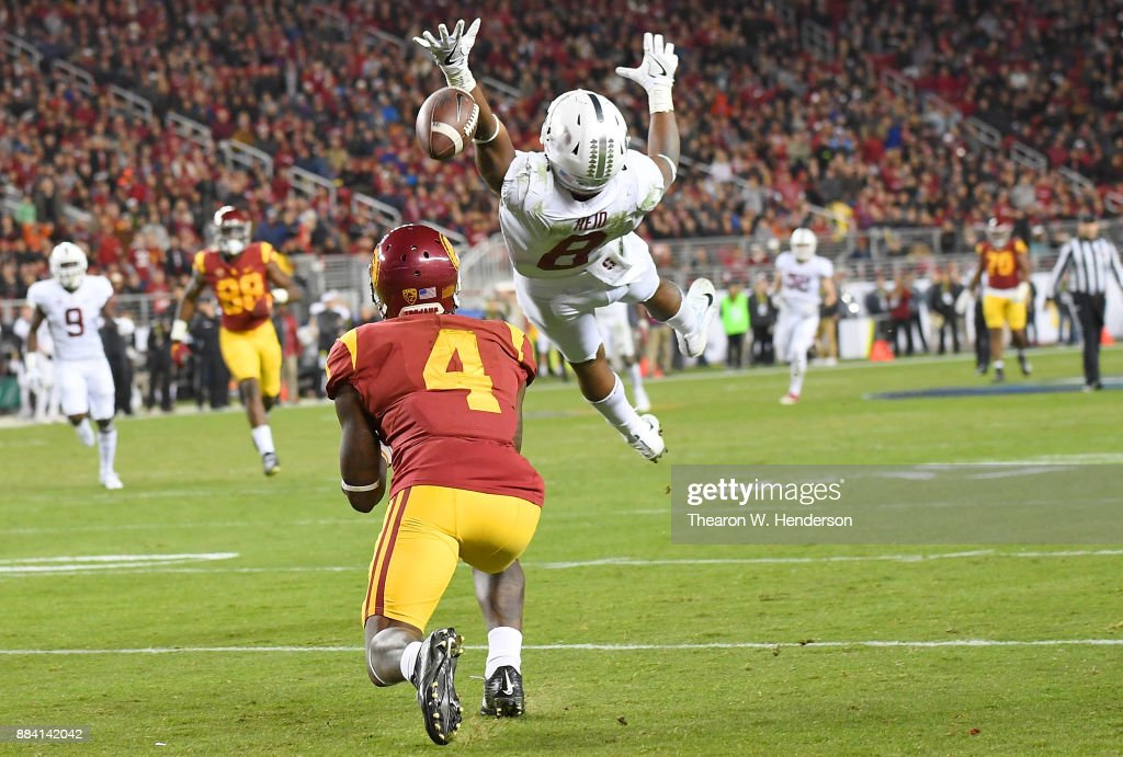 Steven Mitchell Jr. #4 of the USC Trojans catches a long pass at the 1-yard line over Justin Reid #8 of the Stanford Cardinal during the Pac-12 Football Championship Game at Levi's Stadium on December 1, 2017 in Santa Clara, California.