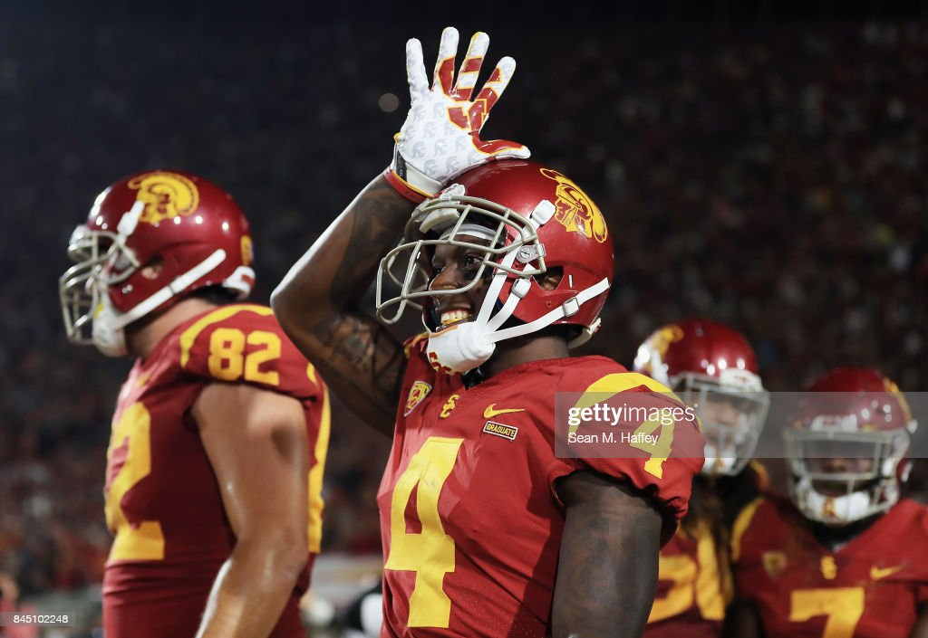 Steven Mitchell Jr. #4 of the USC Trojans celebrates after scoring a fourth quarter touchdown against the Stanford Cardinal at Los Angeles Memorial Coliseum on September 9, 2017 in Los Angeles, California.