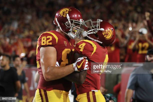 Steven Mitchell Jr #4 of the USC Trojans celebrates with Tyler Petite after scoring a fourth quarter touchdown against the Stanford Cardinal at Los...