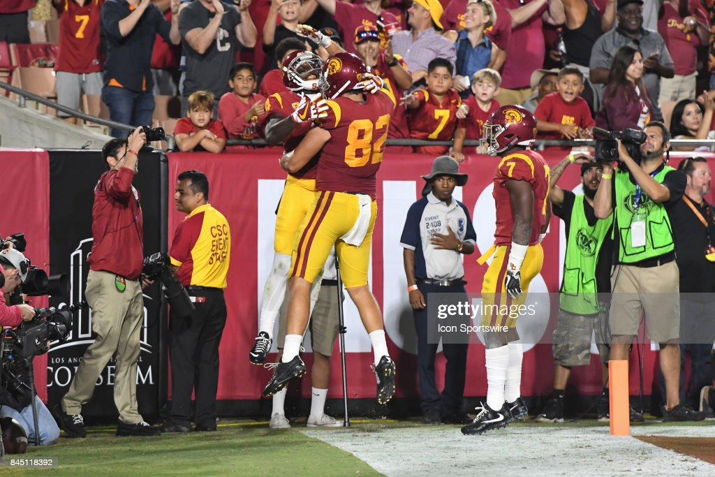 official photos 57c85 f5849 USC Steven Mitchell Jr. celebrates with USC Tyler Petite ...