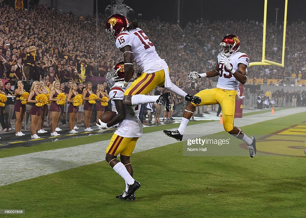 Steven Mitchell Jr #7 of the Southern California Trojans and teammates Isaac Whitney #15 and De'Quan Hampton #89 celebrate a first half touchdown against the Arizona State University Sun Devils at Sun Devil Stadium on September 26, 2015 in Tempe, Arizona.