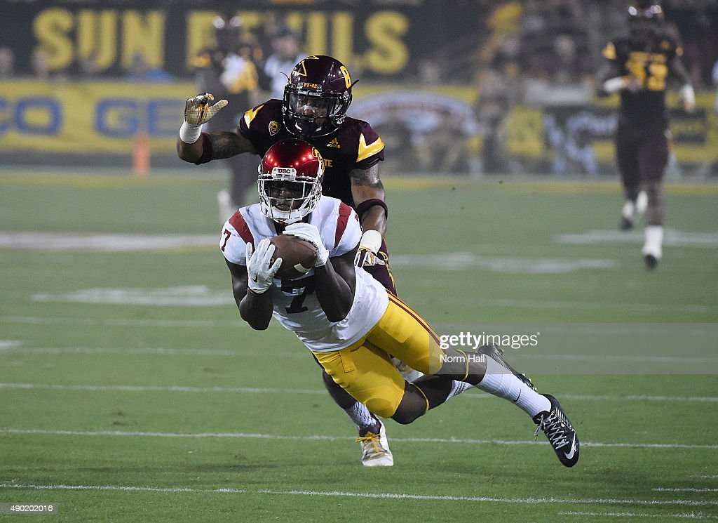 Steven Mitchell Jr #7 of the Southern California Trojans attempts to make a diving catch in front of Lloyd Carrington #8 of the Arizona State University Sun Devils during the first half at Sun Devil Stadium on September 26, 2015 in Tempe, Arizona.