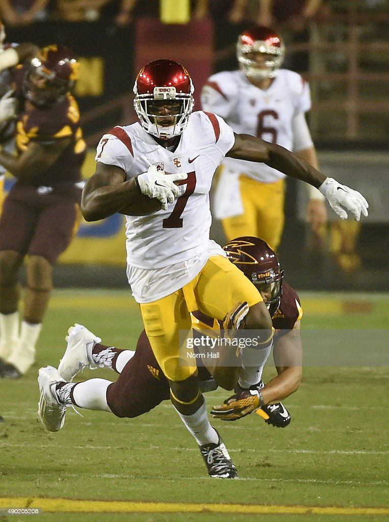 Steven Mitchell Jr #7 of the Southern California Trojans breaks a tackle while running with the ball against the Arizona State University Sun Devils during the second half at Sun Devil Stadium on September 26, 2015 in Tempe, Arizona. Trojans won 42-14.
