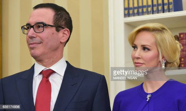 Steven Mnuchin and his financee Louise Linton watch as US President Donald Trump speaks during Mnuchin's swearing-in ceremony as the next treasury...
