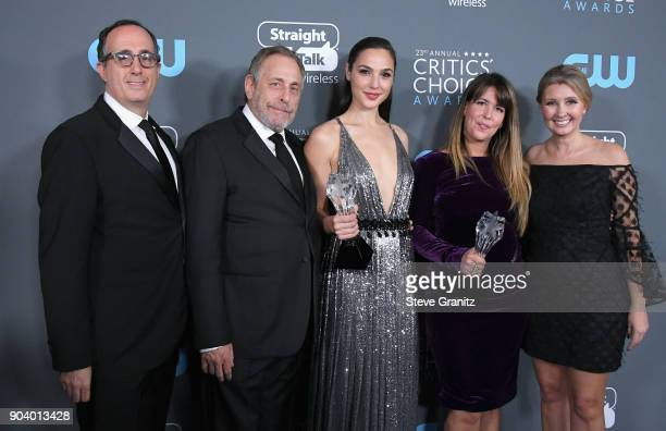 Steven Mnuchin Chuck Roven Gal Gadot Patty Jenkins and Deborah Snyder recipients of the 'Best Action Movie' award for Wonder Woman' pose in the press...