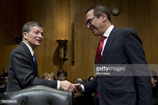 Steven Mnuchin Treasury secretary nominee for presidentelect Donald Trump right shakes hands with Representative Jeb Hensarling a Republican from...