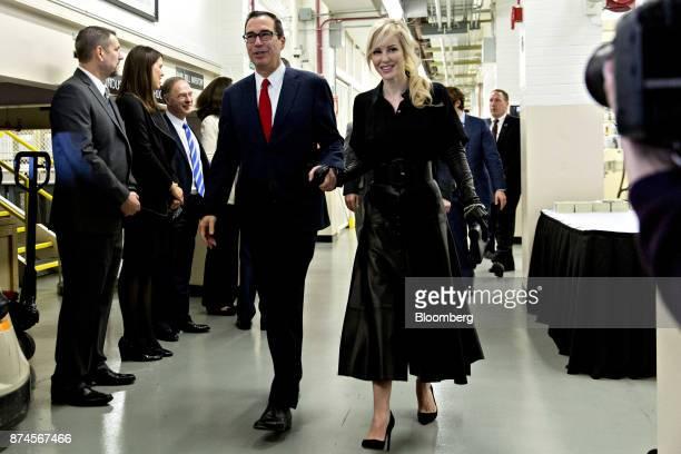 Steven Mnuchin US Treasury secretary center and his wife Louise Linton walk through the US Bureau of Engraving and Printing in Washington DC US on...