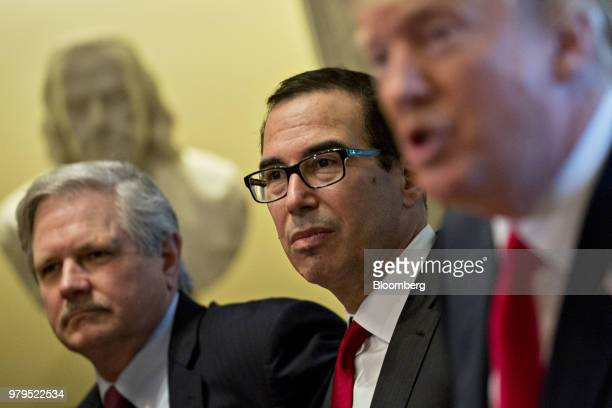 Steven Mnuchin US Treasury secretary center and Senator John Hoeven a Republican from North Dakota listen as US President Donald Trump right speaks...