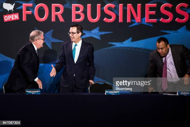 Steven Mnuchin US Treasury secretary center greets Guillermo DiazRoussekoy president and chief executive officer of the Continental National Bank...