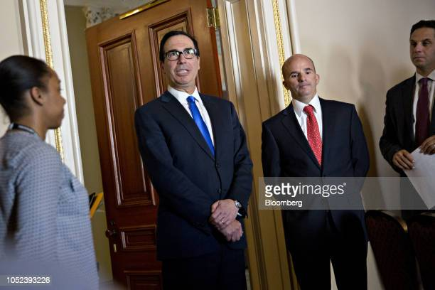 Steven Mnuchin US Treasury secretary center left speaks to members of the media as Jose Antonio Gonzalez Anaya Mexico's finance minister second right...
