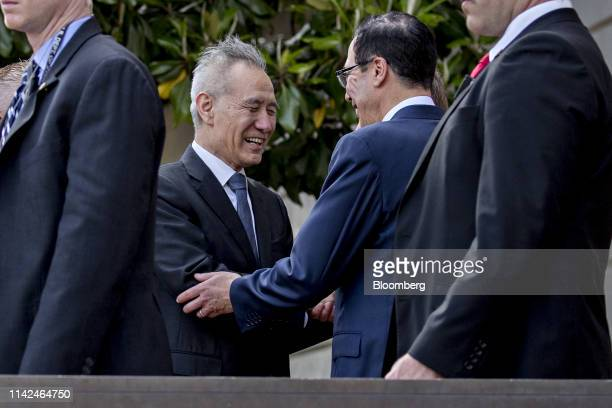 Steven Mnuchin US Treasury secretary center right greets Liu He China's vice premier center left outside the Office of the US Trade Representative in...