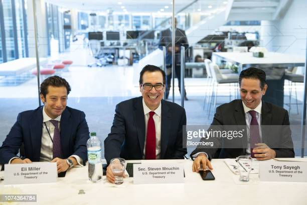 Steven Mnuchin US Treasury secretary center smiles while Eli Miller chief of staff at the US Treasury left and Tony Sayegh spokesman for the US...