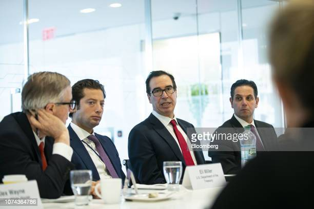 Steven Mnuchin US Treasury secretary center speaks during an interview in Washington DC US on Tuesday Dec 18 2018 The White House signaled a possible...