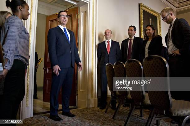 Steven Mnuchin US Treasury secretary center speaks to members of the media as Jose Antonio Gonzalez Anaya Mexico's finance minister fourth right...