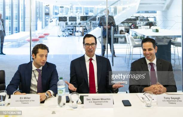 Steven Mnuchin US Treasury secretary center speaks while Eli Miller chief of staff at the US Treasury left and Tony Sayegh spokesman for the US...