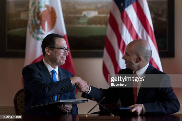 Steven Mnuchin US Treasury secretary left and and Jose Antonio Gonzalez Anaya Mexico's finance minister shake hands after signing a memorandum of...