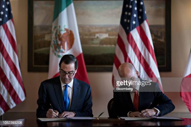 Steven Mnuchin US Treasury secretary left and and Jose Antonio Gonzalez Anaya Mexico's finance minister sign a memorandum of understanding to update...