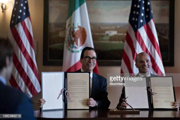Steven Mnuchin US Treasury secretary left and and Jose Antonio Gonzalez Anaya Mexico's finance minister hold up a memorandum of understanding to...