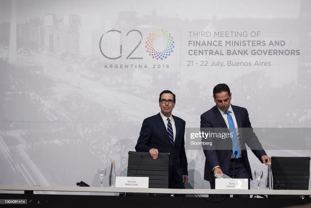 Steven Mnuchin, U.S. Treasury secretary, left, and Tony Sayegh, spokesman for the U.S. Treasury Department, arrive at a news conference during the G-20 finance ministers and central bankers meetings in Buenos Aires, Argentina, on Sunday, July 22, 2018. Mnuchin said that there is no chance of a currency war erupting despite U.S. President Donald Trump tweets.