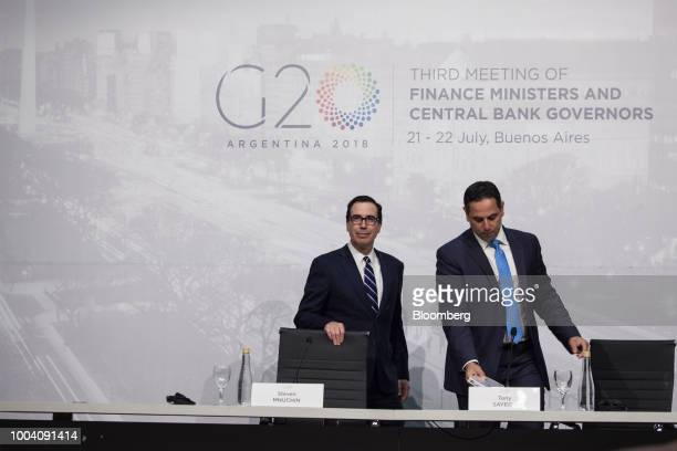 Steven Mnuchin US Treasury secretary left and Tony Sayegh spokesman for the US Treasury Department arrive at a news conference during the G20 finance...