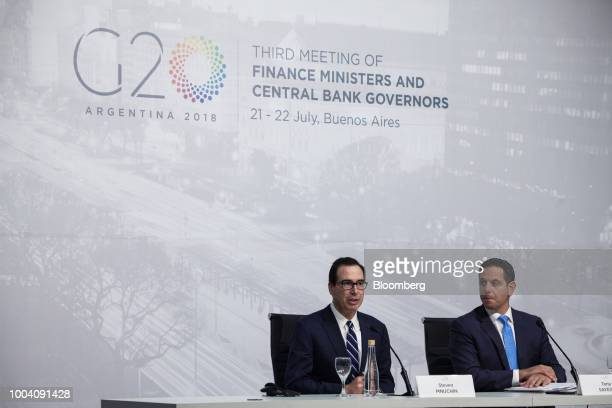Steven Mnuchin US Treasury secretary left speaks as Tony Sayegh spokesman for the US Treasury Department listens at a news conference during the G20...