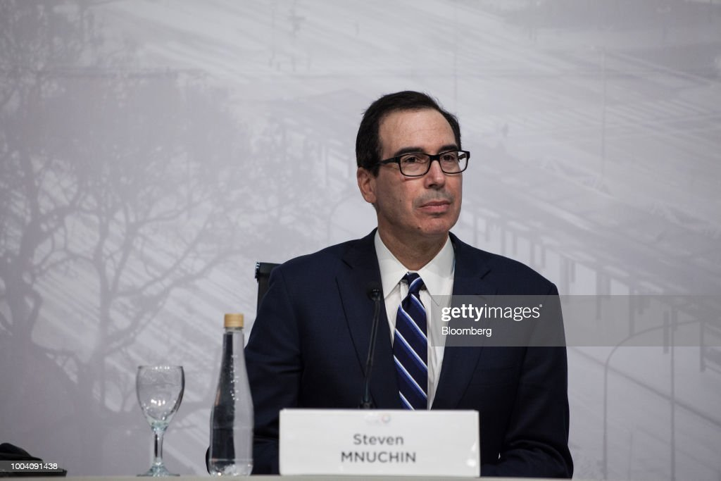 Steven Mnuchin, U.S. Treasury secretary, listens at a news conference during the G-20 finance ministers and central bankers meetings in Buenos Aires, Argentina, on Sunday, July 22, 2018. Mnuchin said that there is no chance of a currency war erupting despite U.S. President Donald Trump tweets.