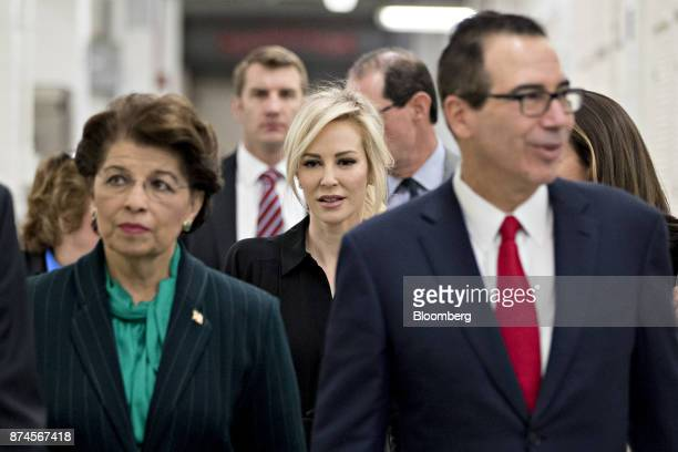 Steven Mnuchin, U.S. Treasury secretary, right, and his wife Louise Linton, center, tour the U.S. Bureau of Engraving and Printing in Washington,...