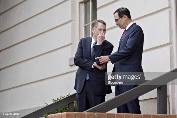 Steven Mnuchin US Treasury secretary right and Robert Lighthizer US trade representative wait to greet Liu He China's vice premier not pictured...